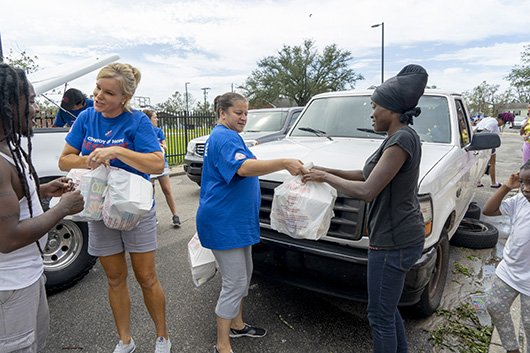 COH volunteers handing out vital supplies and food.